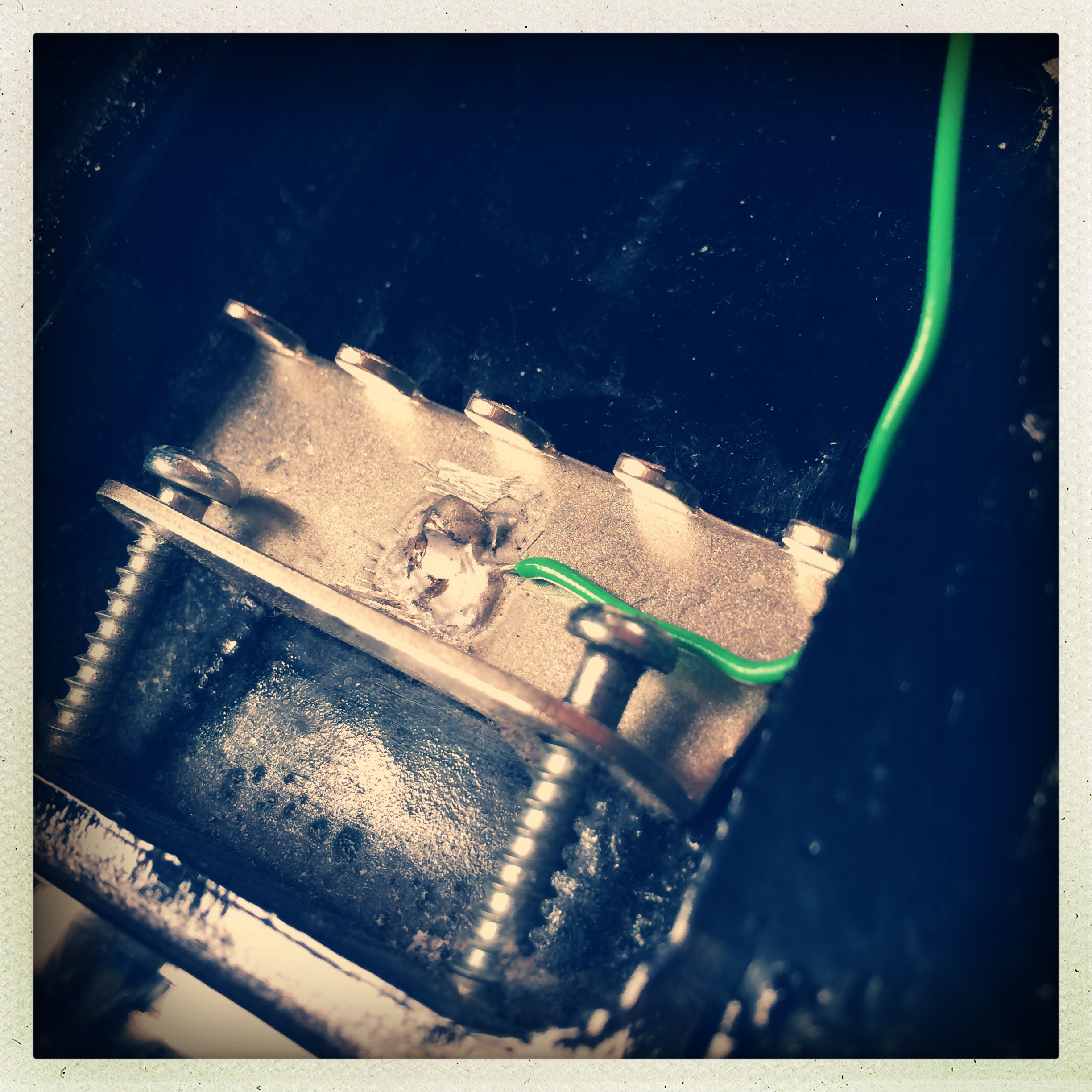 Soldering a wire to the tremolo claw is a more 'traditional' way to ground a Strat's strings