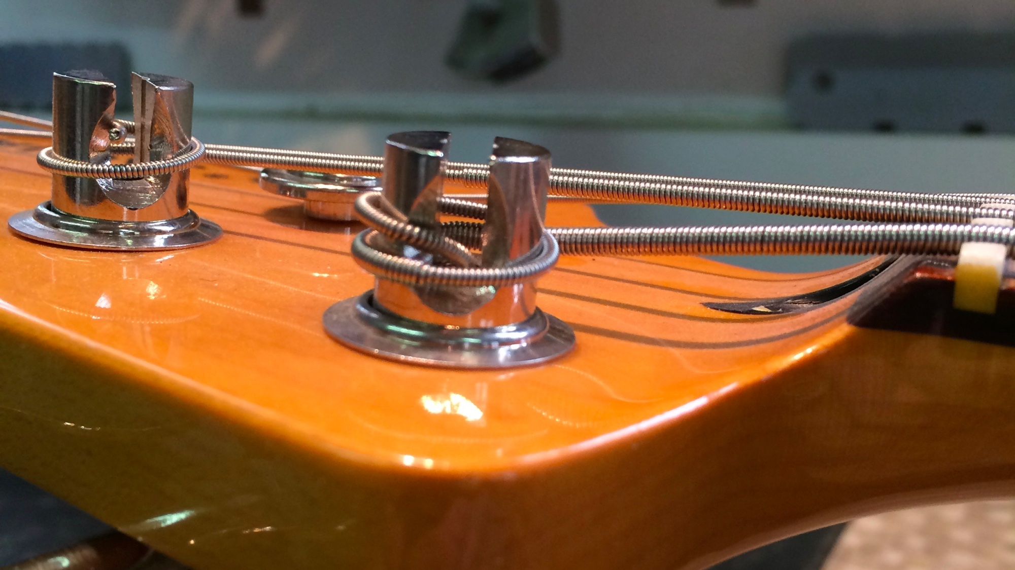 The string break angle on the second string is too shallow, causing buzzing when played open.
