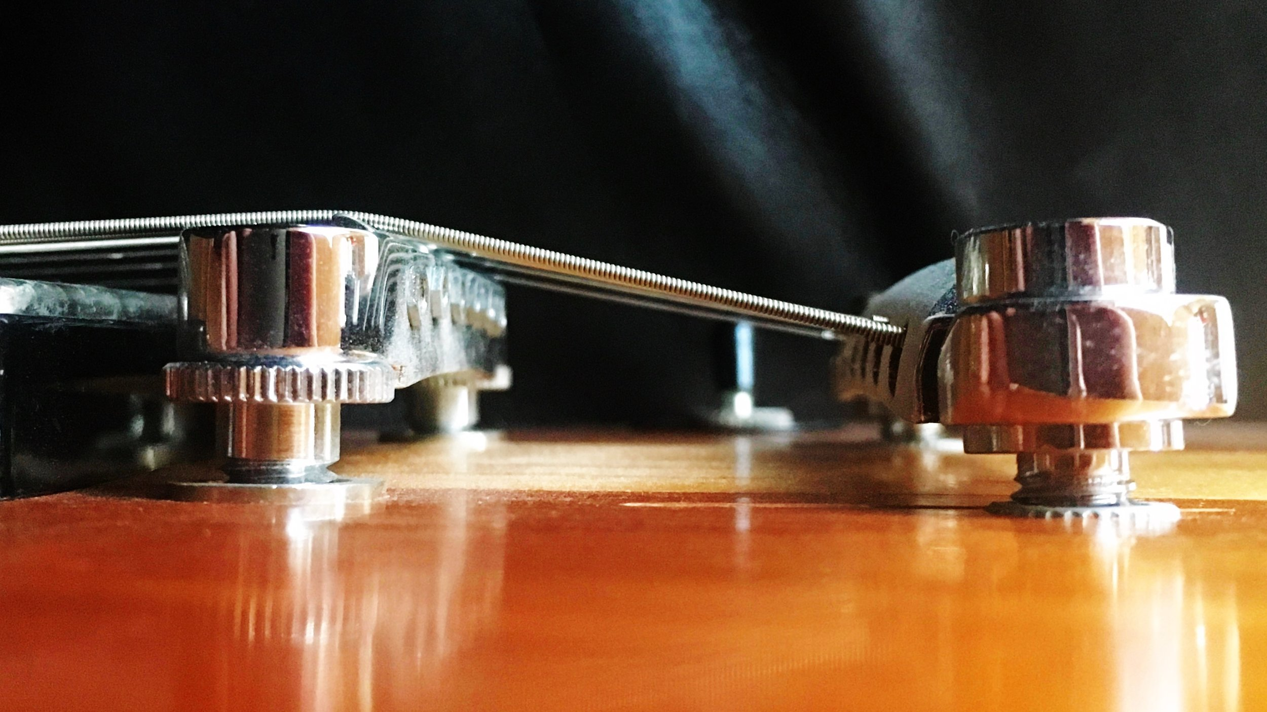 Gibson bridge and tailpiece string angle.