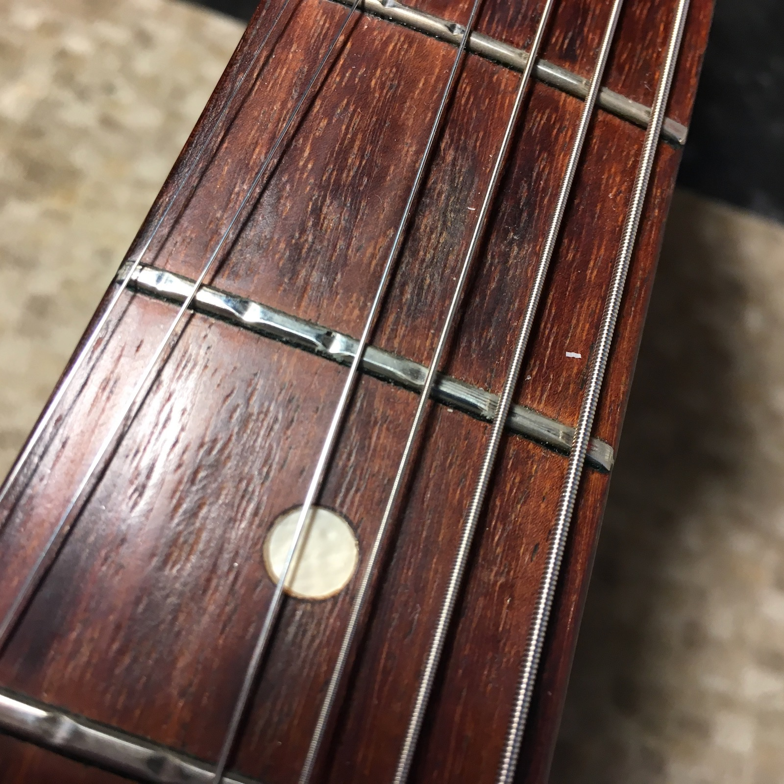 Push your strings to the side and check for fret wear