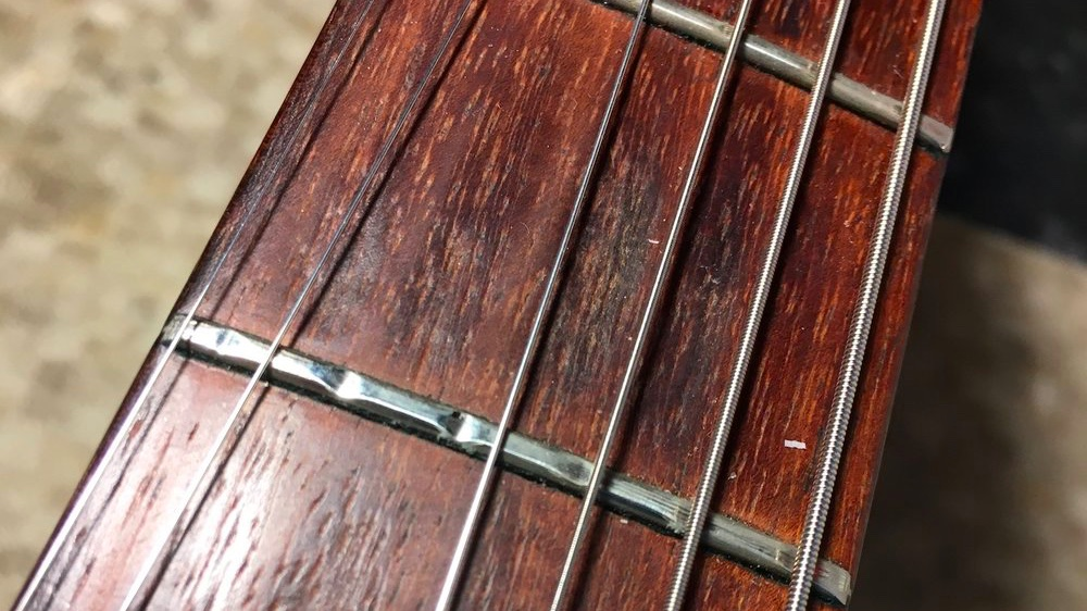 Fret condition can have an impact on how well a guitar can be setup