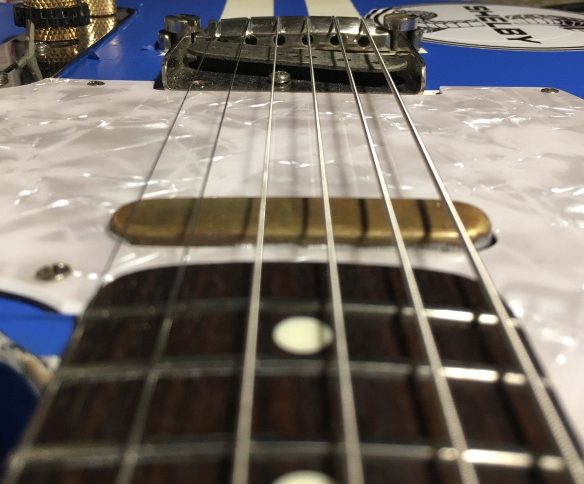 String action more consistent when bridge matches fingerboard radius.