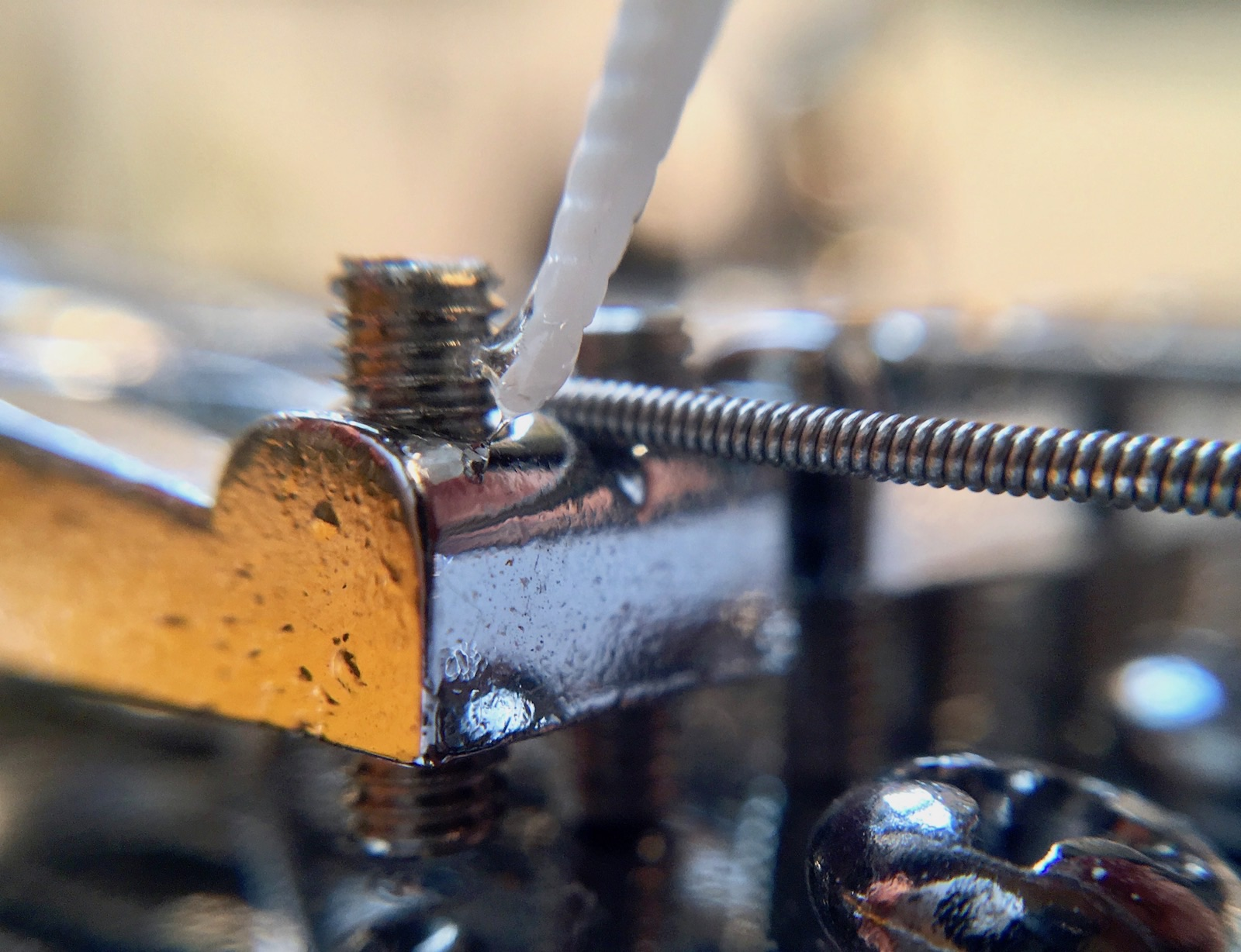 A tiny drop of lacquer, nail varnish, or thread-locking fluid will keep loose saddle screws in place