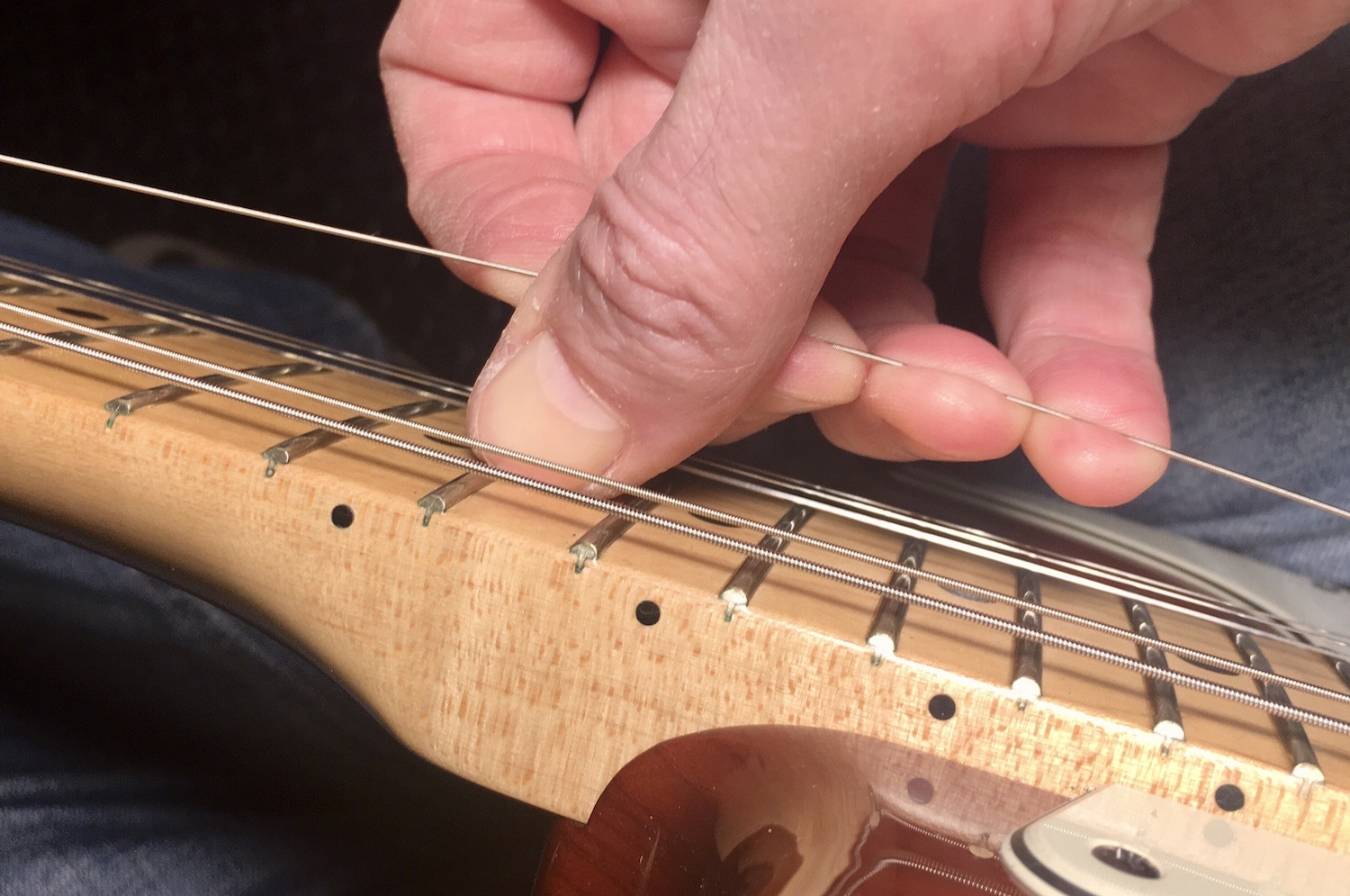 How much to stretch strings
