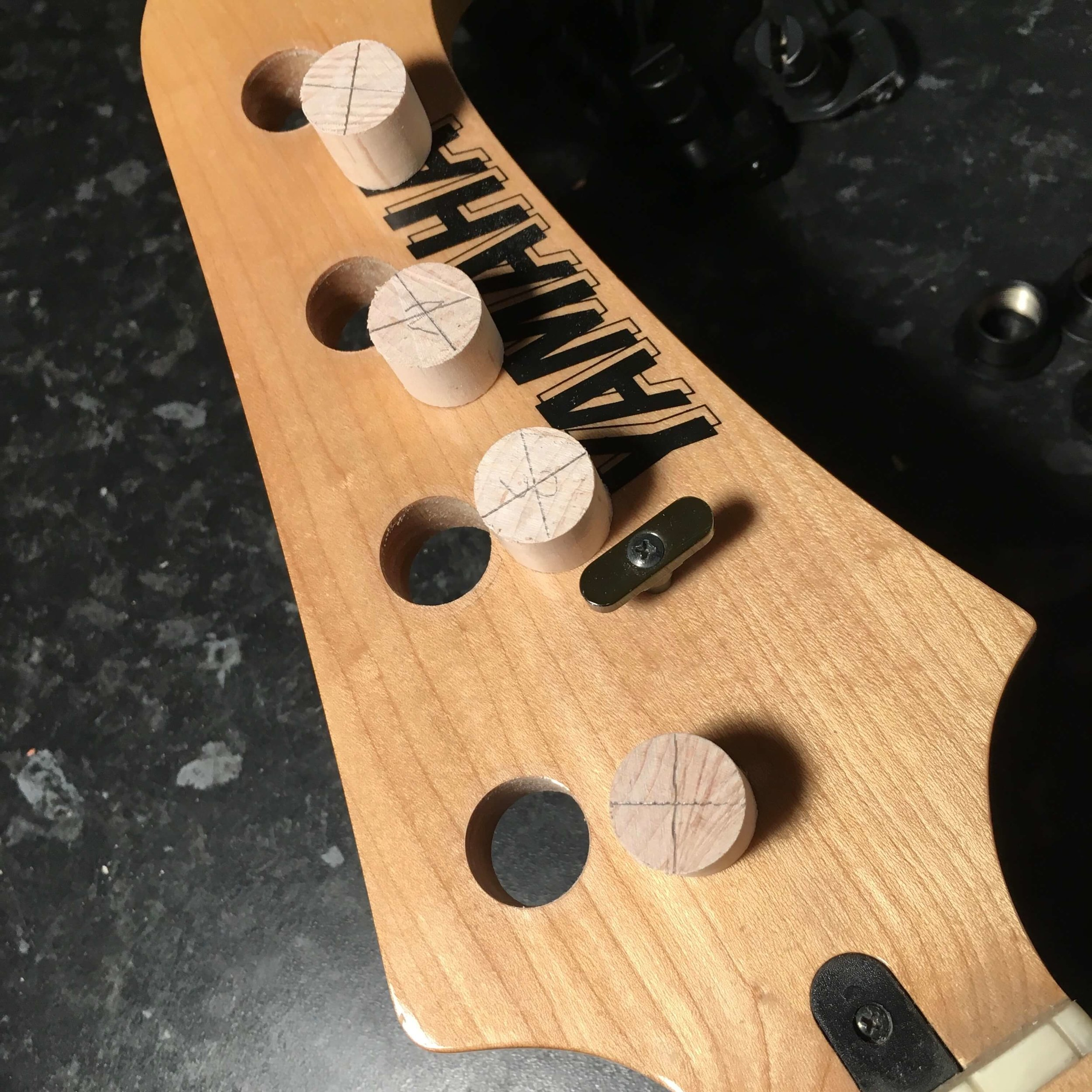 Fitting smaller tuners means plugging the holes in this headstock.