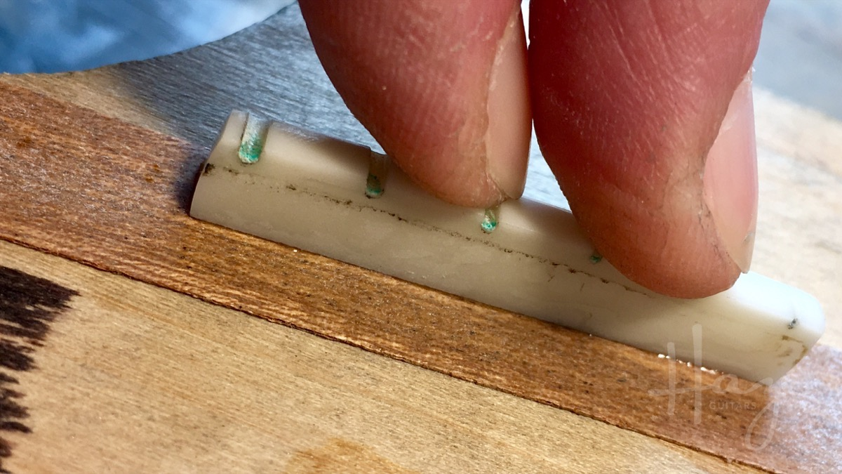 Glueing nut to hard wood shim