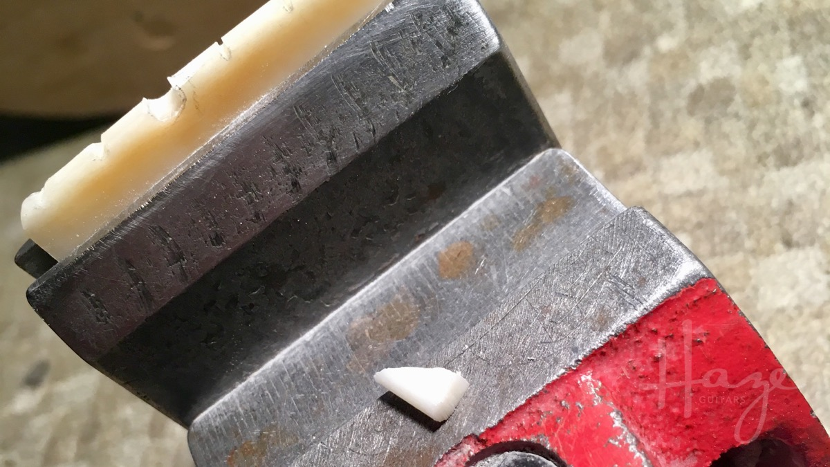 Trim the excess, leaving your graft piece a little larger than the edges of the nut.