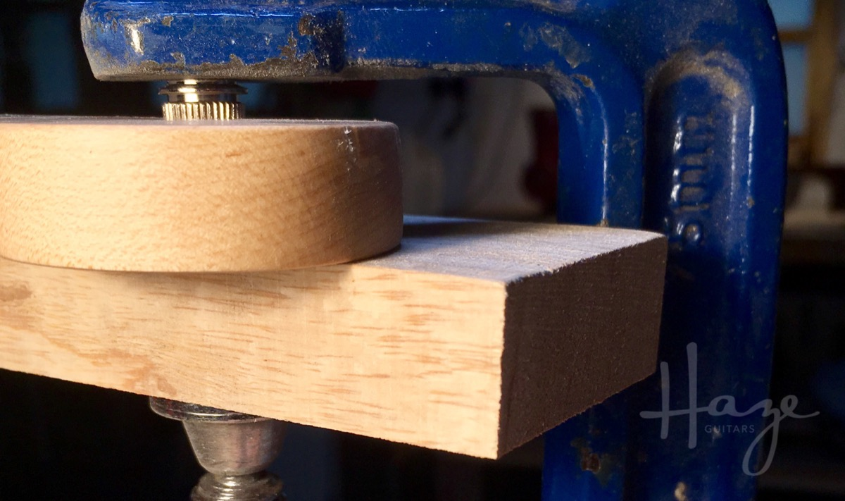 Using a clamp to seat bushings