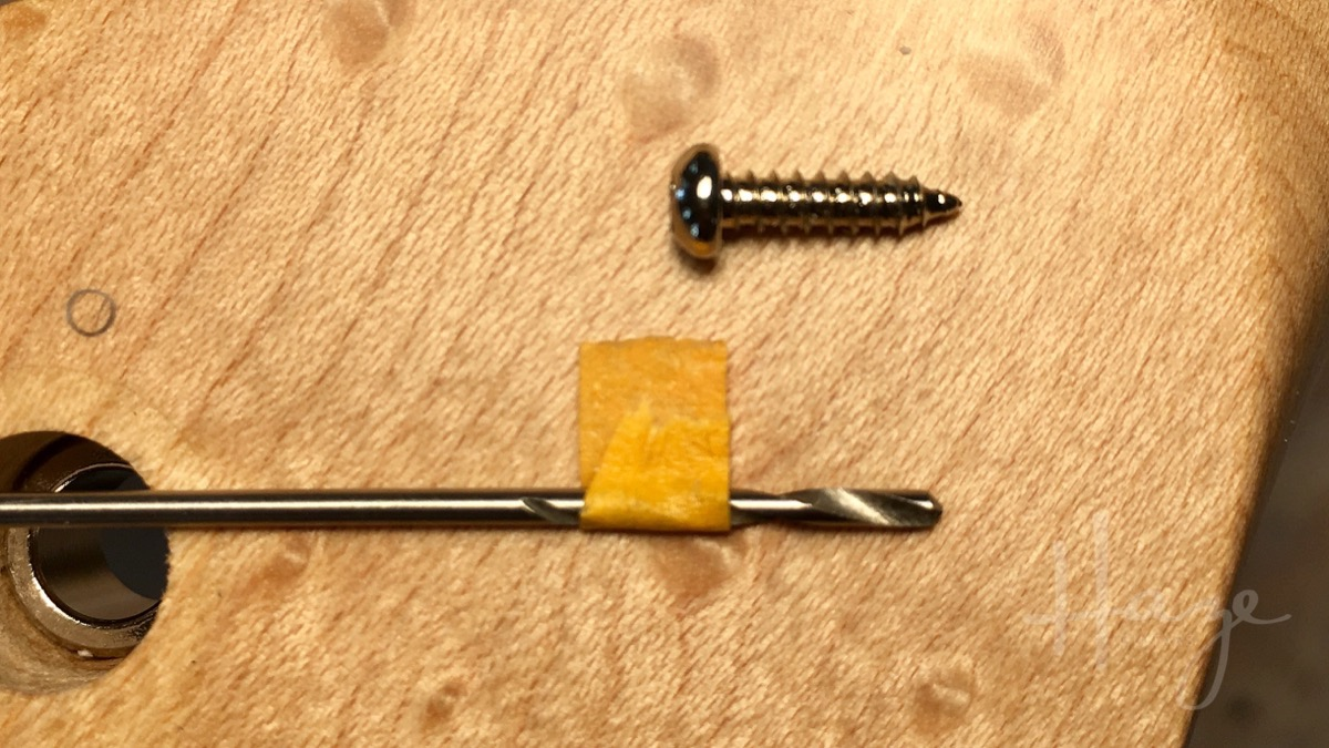 Don't drill too deeply (you don't want to drill out the other side of the headstock)