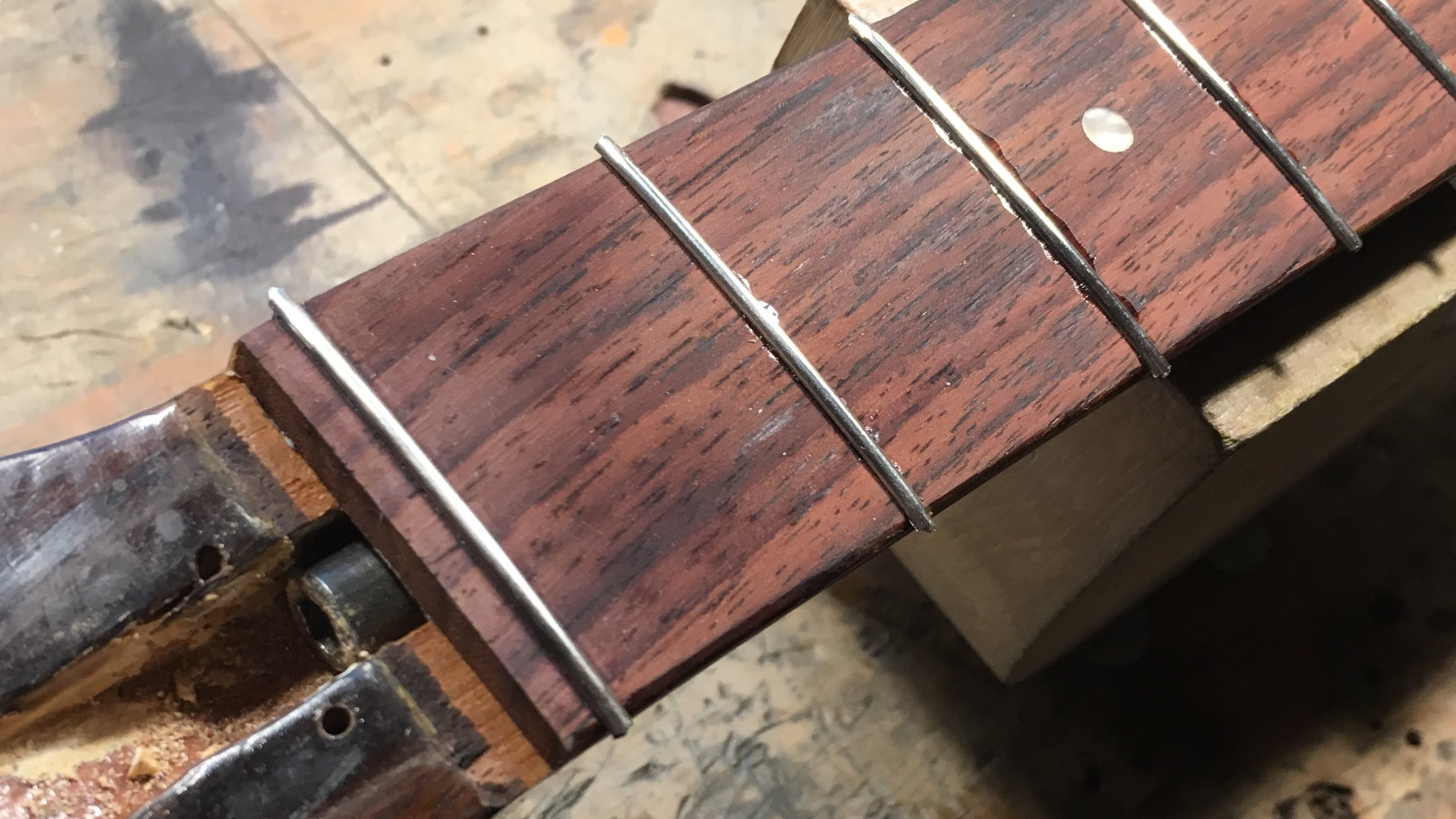What do you do with a zero fret when you're refretting or levelling frets?