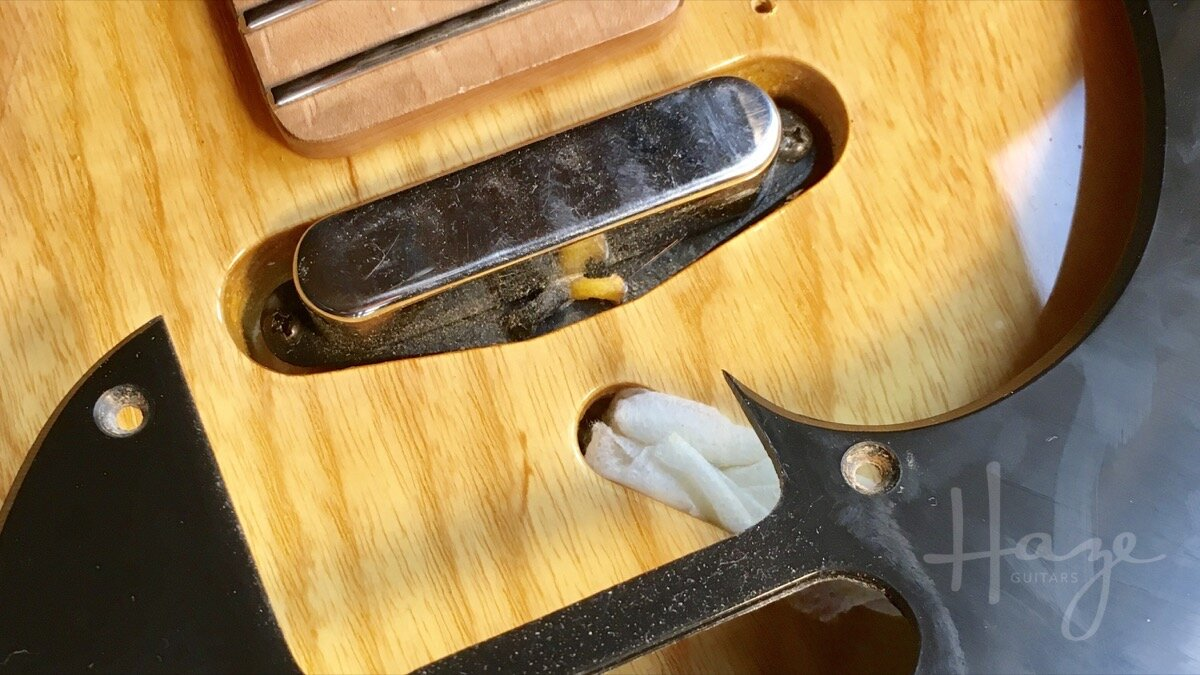 Removing the pickguard to access the Tele pickup height adjustment screws