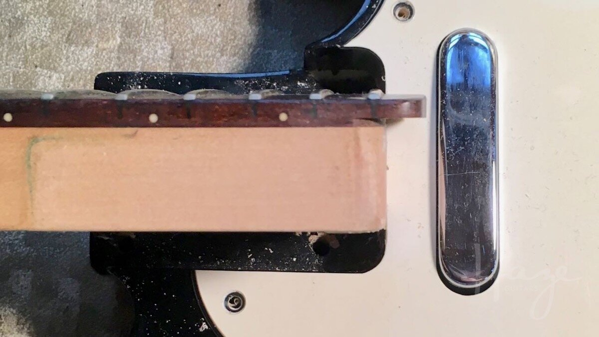 Many 22-fret necks have a fingerboard extension which overhangs the pickguard, preventing removal.