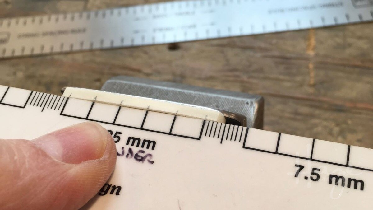 Using a string-spacing ruler for slot positions. It's really easy to do by eye on the guitar though.