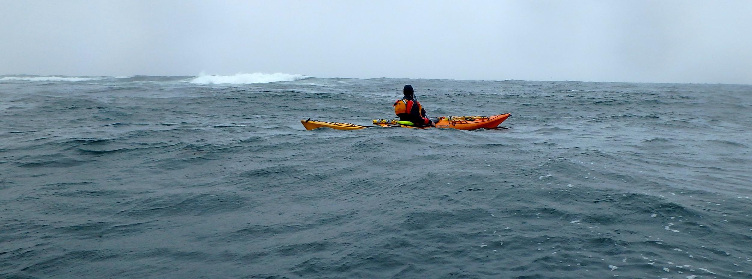 Swell breaks over McKenney Point, Photo: Joe Guglielmetti