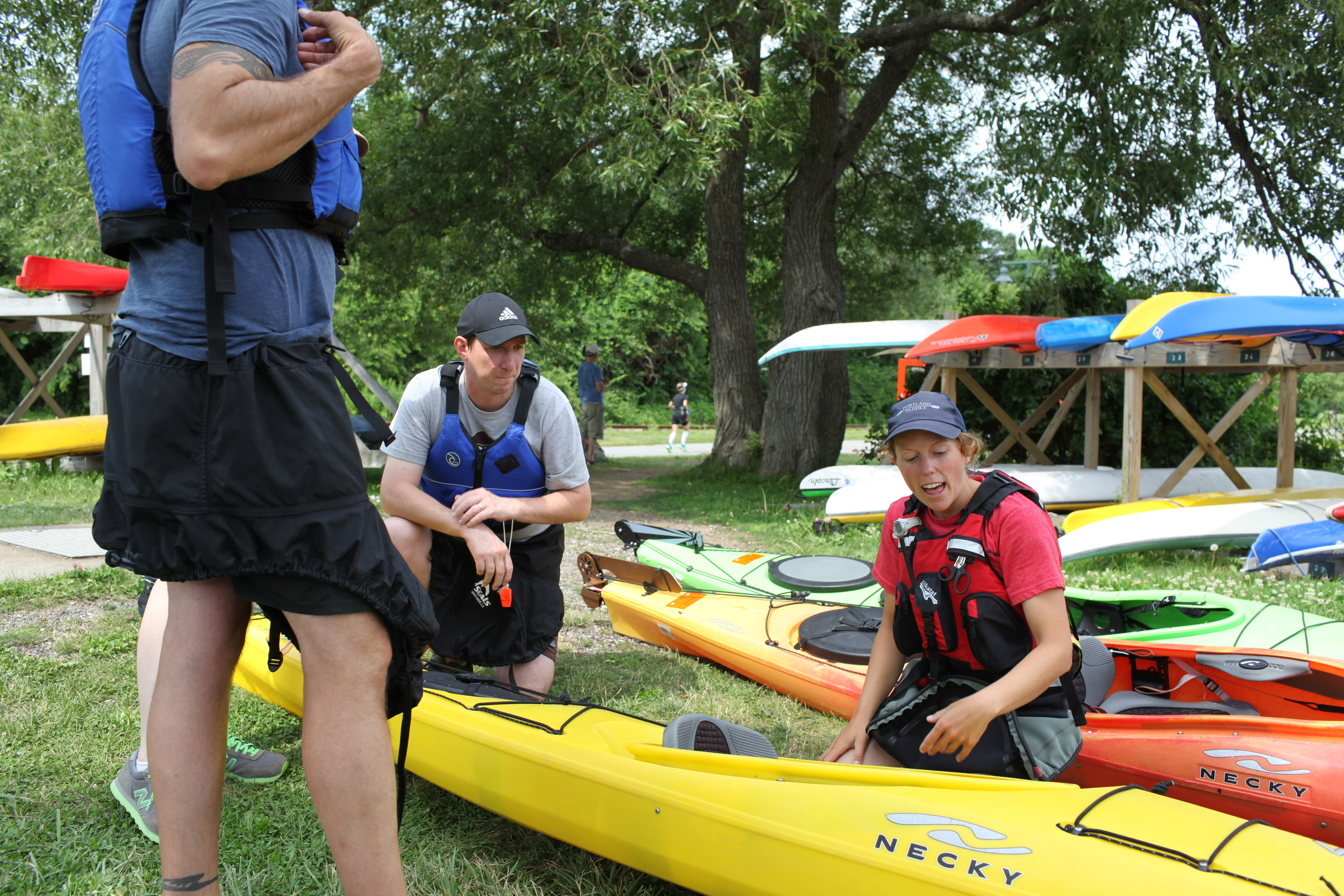 Giving a quick lesson on the parts of a sea kayak