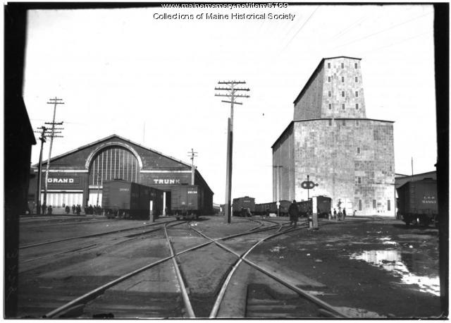 You'll paddle past the burnt pilings that once supported wharves servicing the Grand Trunk Railway and it's massive grain elevator. (Maine Memory Network)