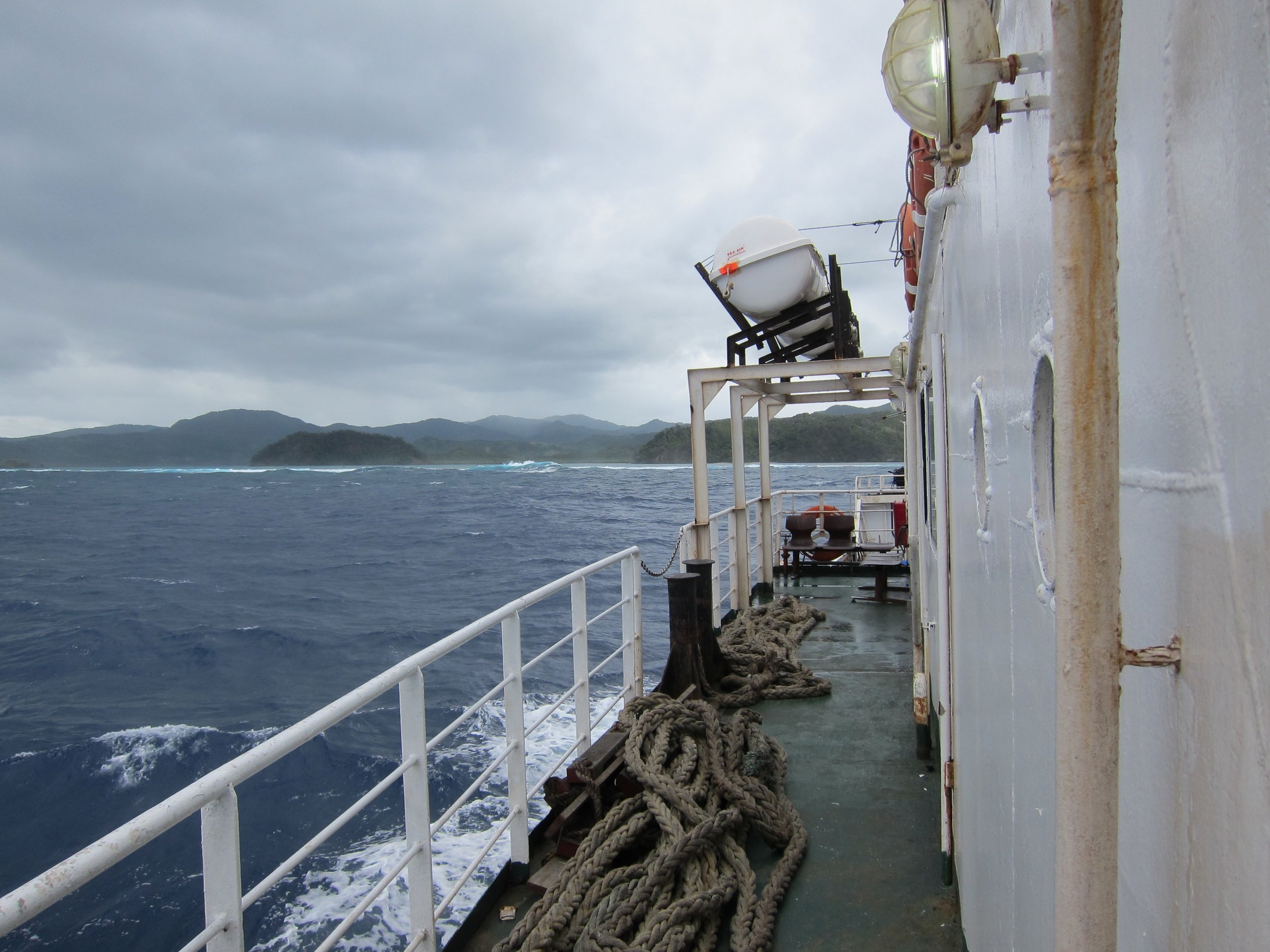 4  The ferry approaching the Great Astrolabe Reef, Kadavu behind (1).jpg