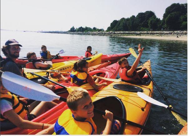Kids kayaking with Zack.JPG