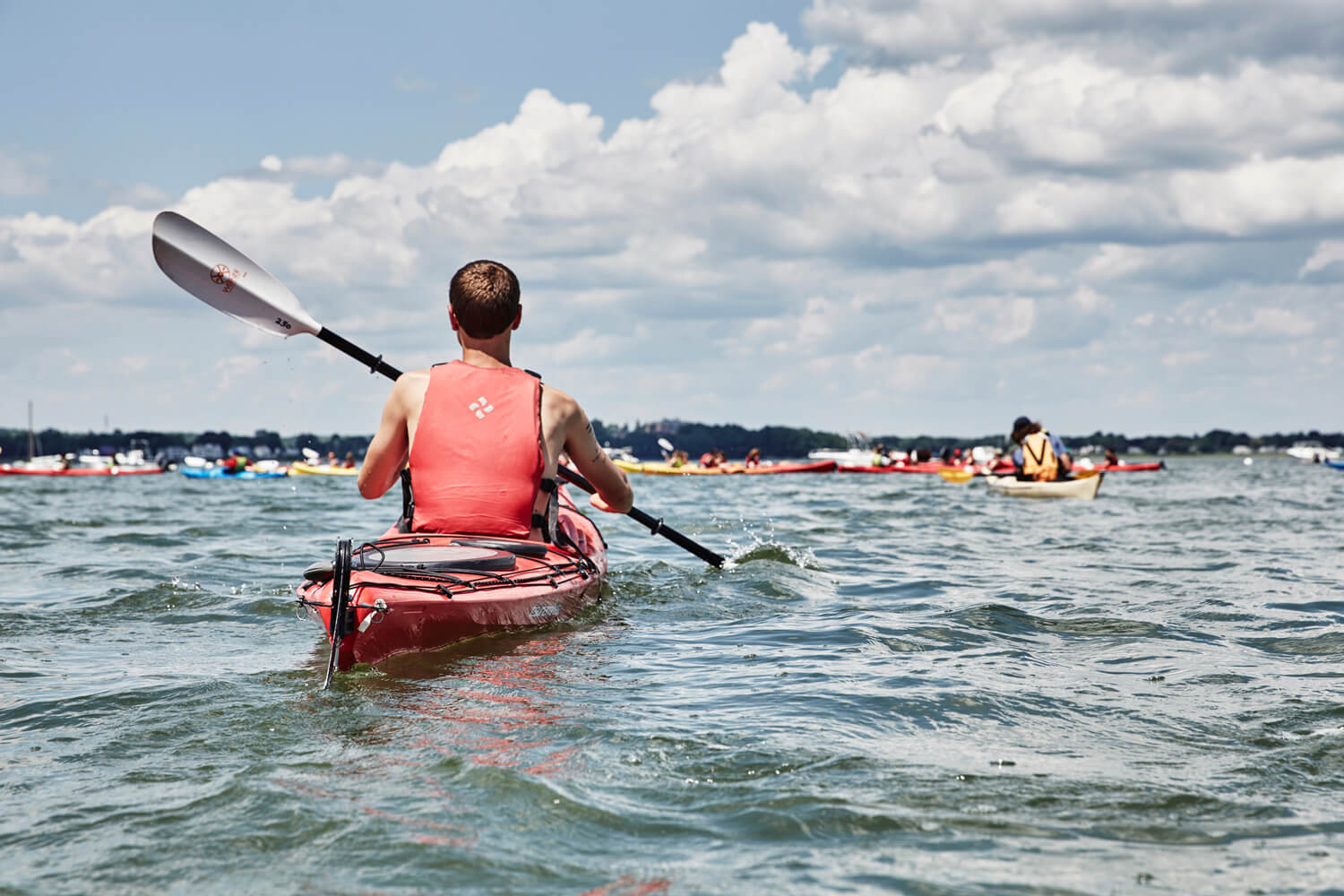 Solo Paddler in Casco Bay on a Tour