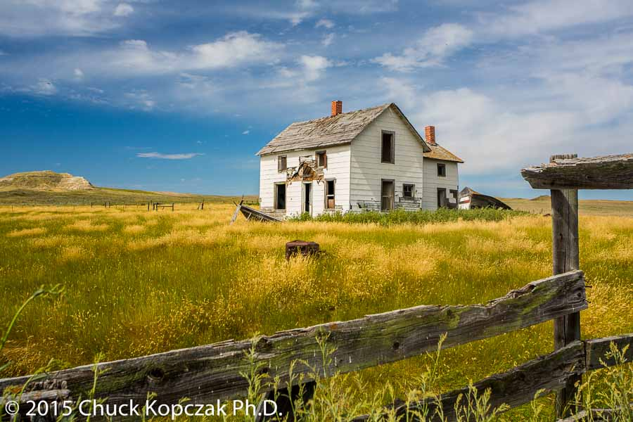 A ranch house sits abandon and decaying near Winifred, Montana, on the Great Plains of North America.