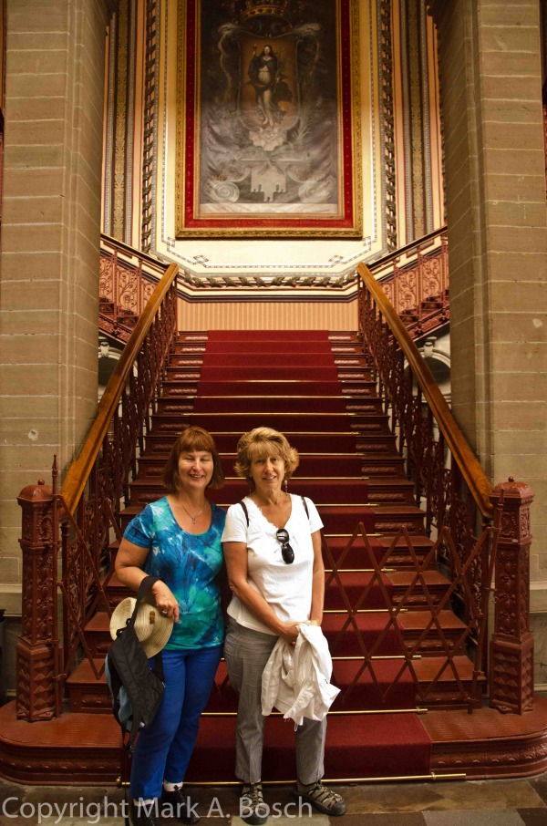 Two lovely ladies pose at the foot of Opera House Grand Staircase