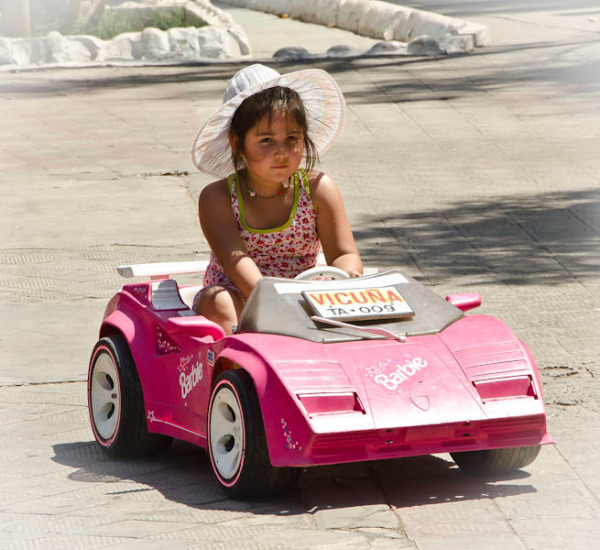 Young girl driving her electric car - Vicuna town center