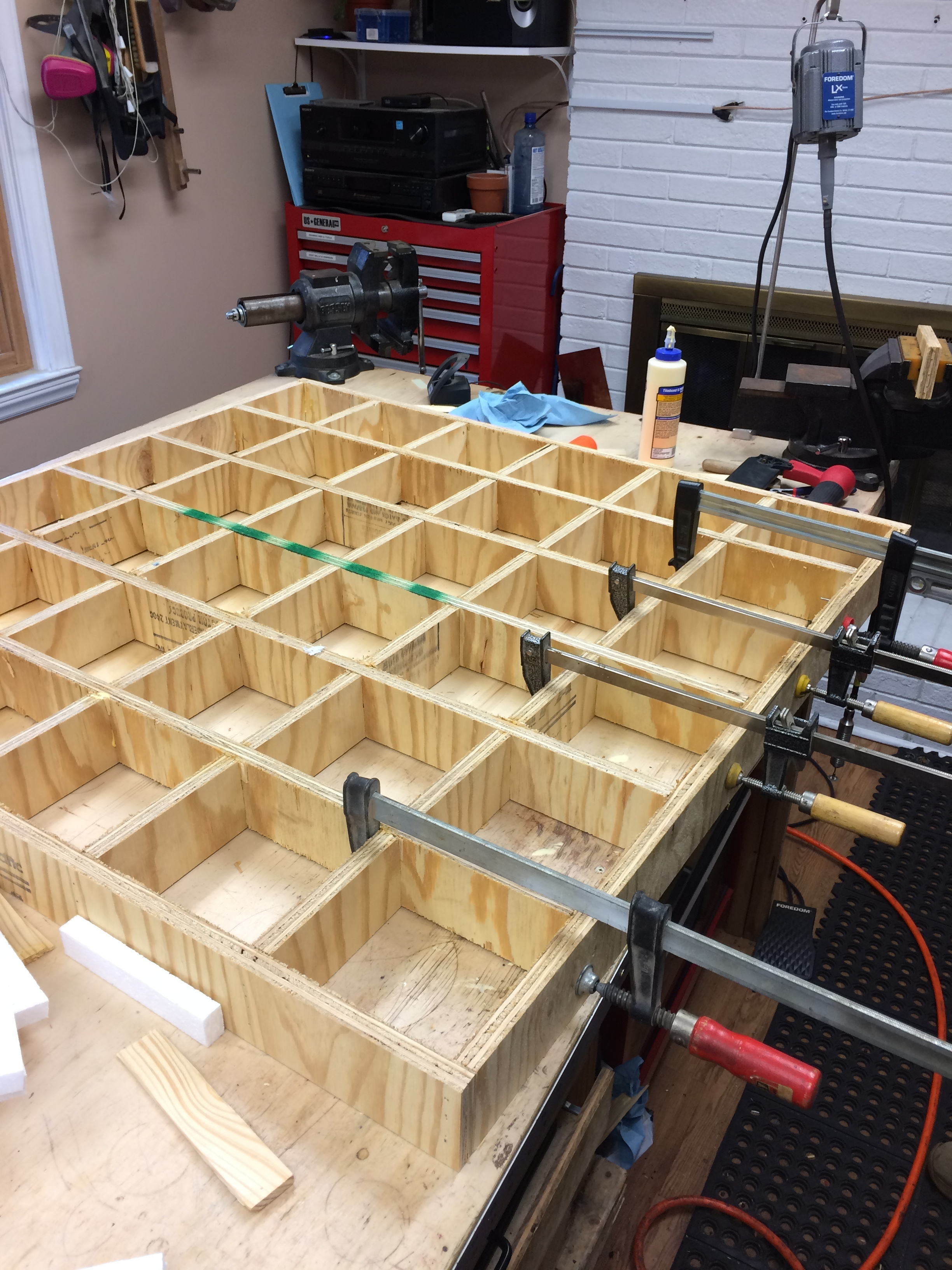 A torsion box relies on a grid inside the box to prevent flex and add significant rigidity.