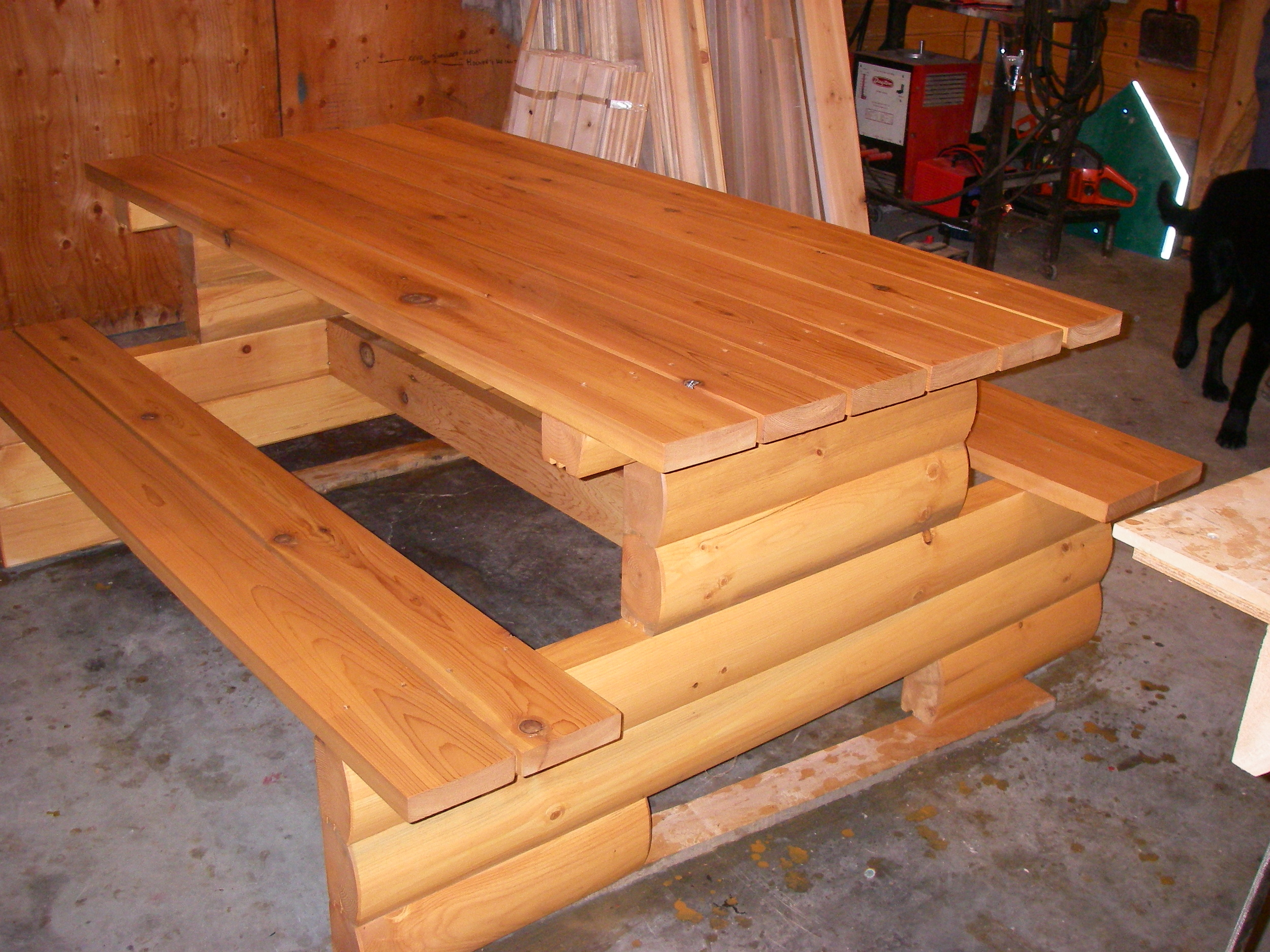 Pine log picnic table