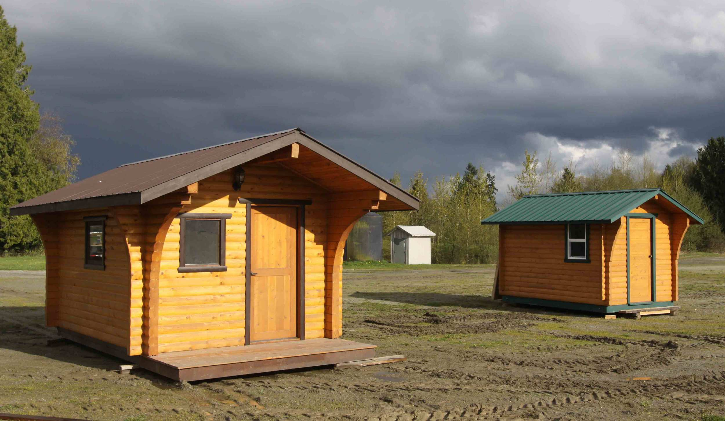 "Left: Guest House using RB 6x6"" Pine D-log Right: Outdoor Sauna made with RB 4x6"" Pine D-log"