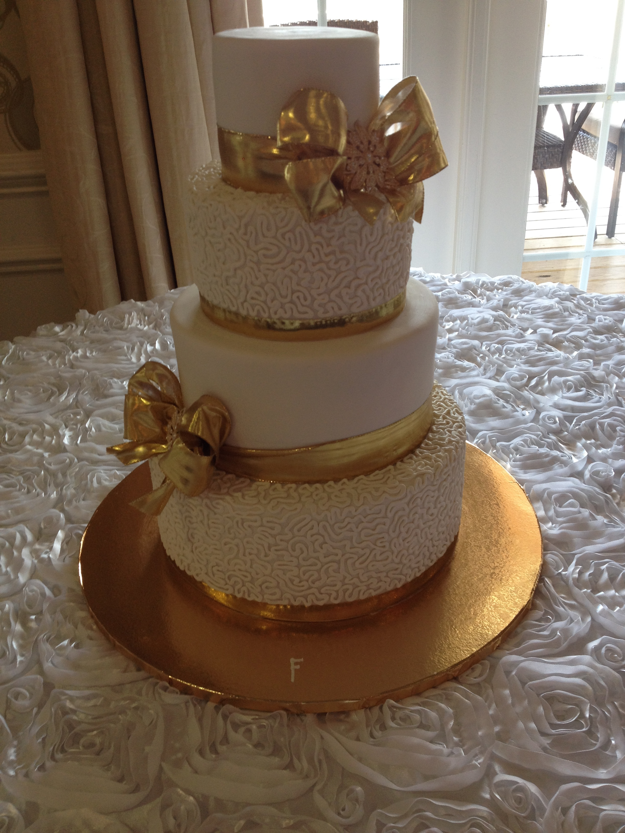 Gold Bows with Broach Wedding Cake