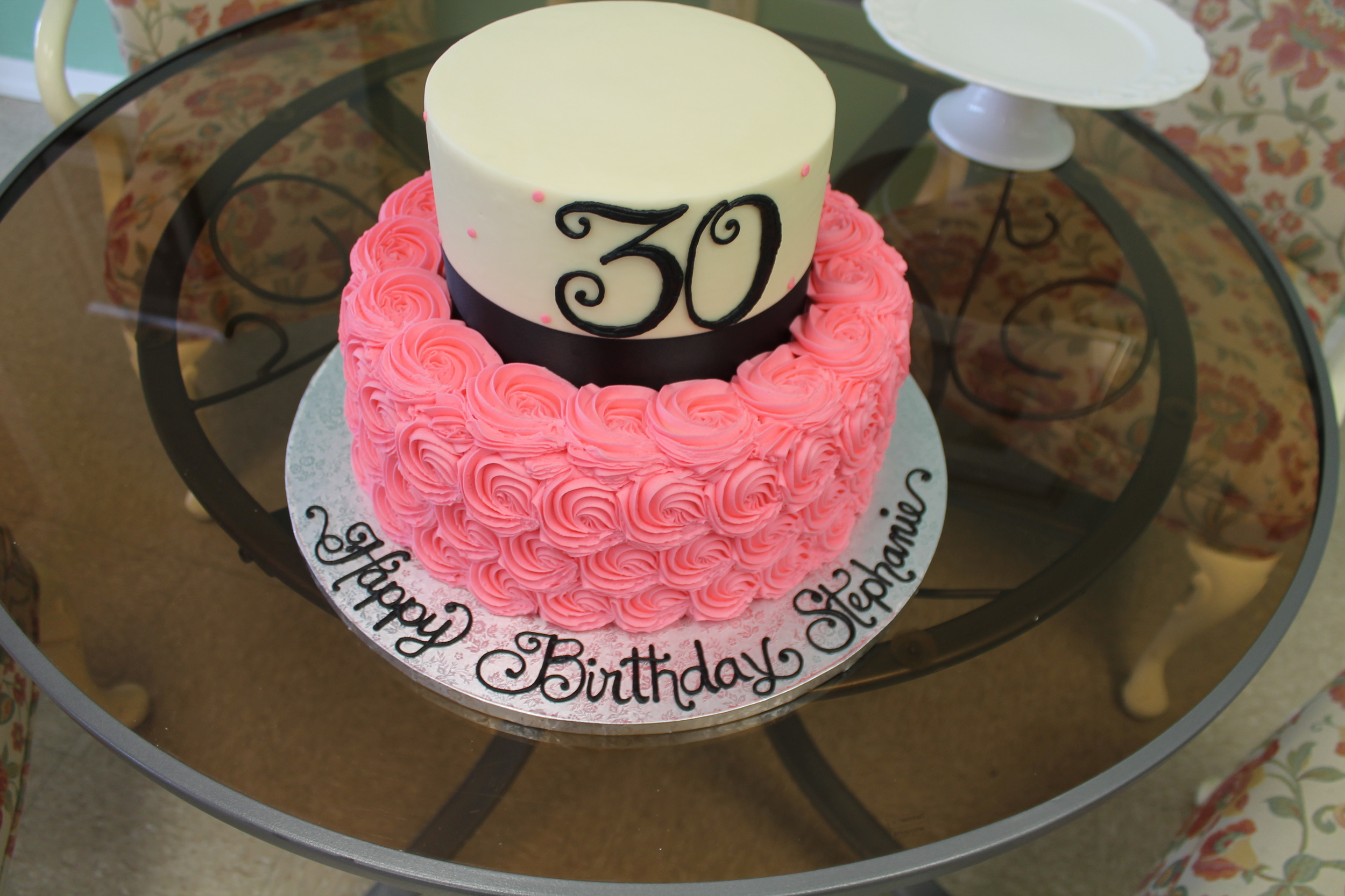 Pink Rosettes with Black Birthday Cake