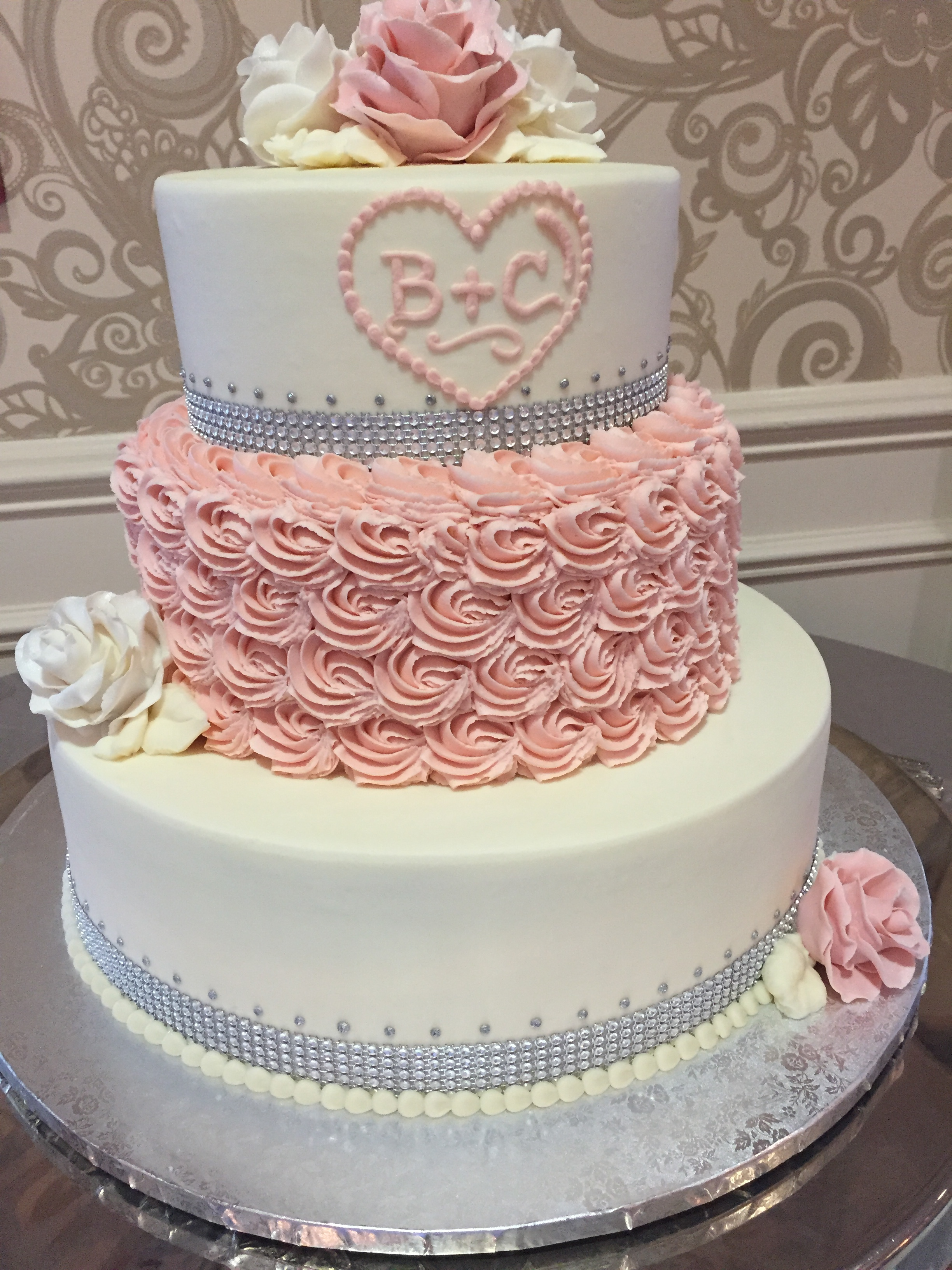 Pink Roses and Rosettes Wedding Cake