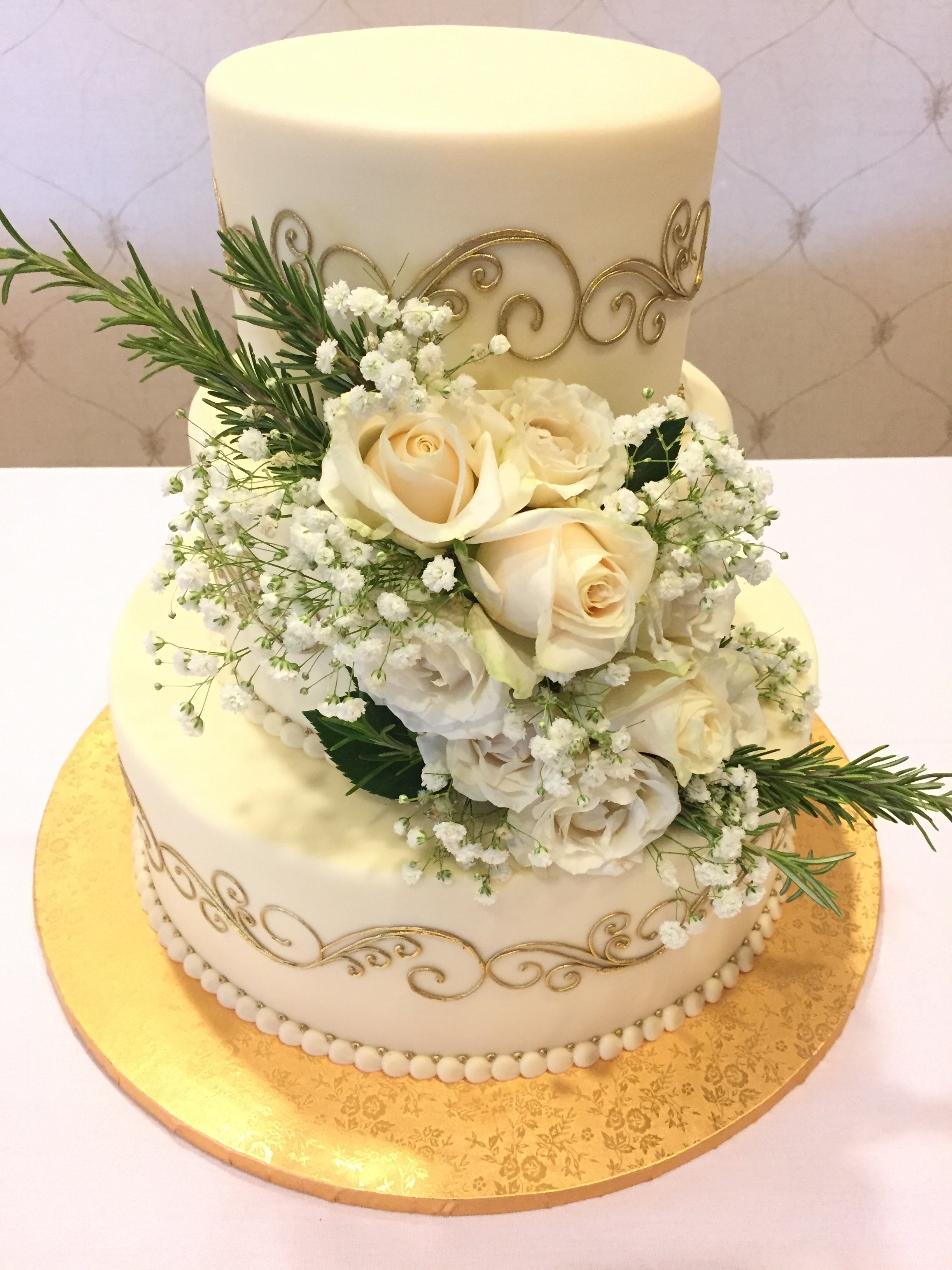 White Roses and Rosemary for a Wedding Cake