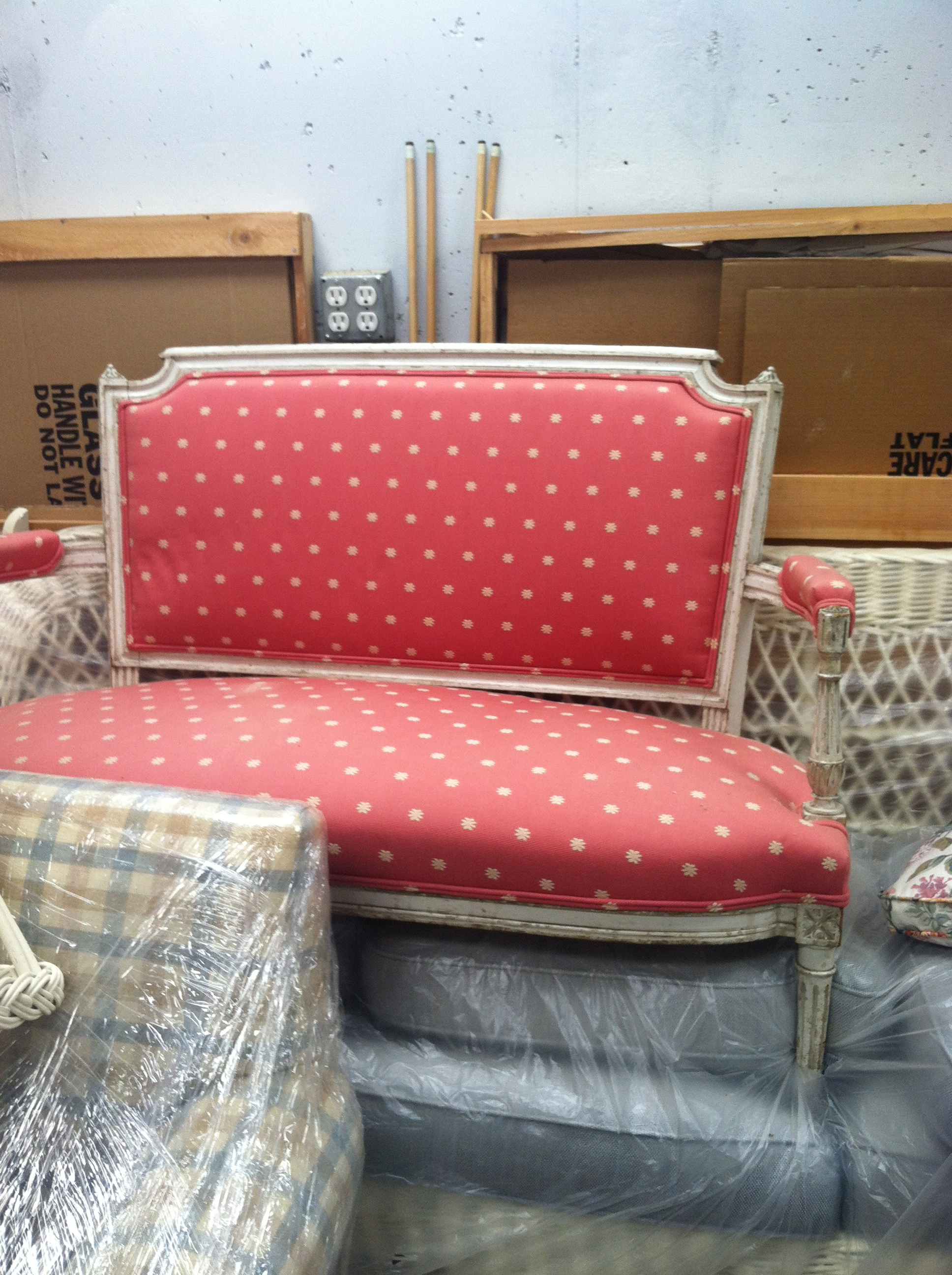 Before: Pink upholstered settee with beautiful lines.