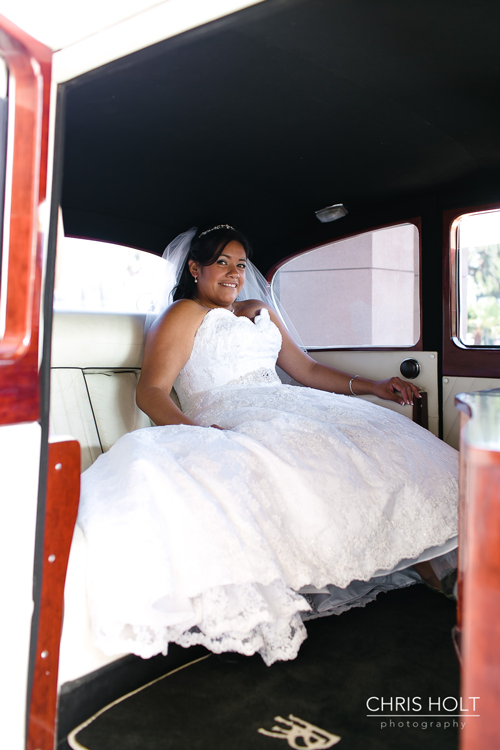 wedding photo of bride in rolls royce