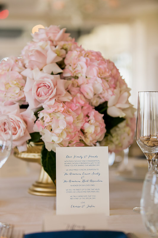 pink and white floral centerpiece with menu at Summit House Restaurant in Fullerton, CA
