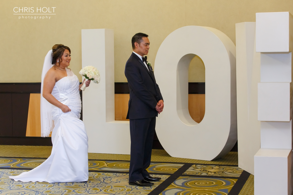 first look, contemporary, bride, groom, happy, excited, anxious, anticipation, kiss, wedding gown, dress, suit, tux,