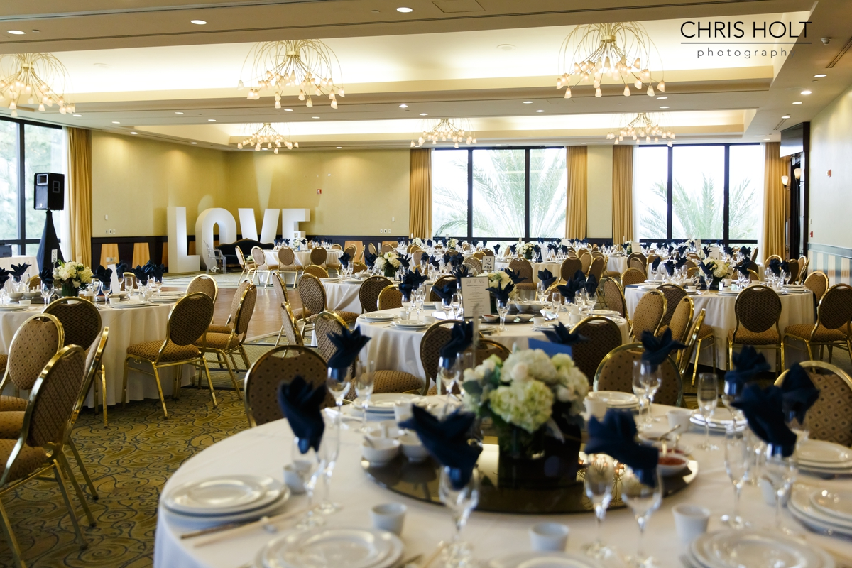 reception, venue, ballroom, centerpieces, love, resort, cake, cupcakes, bundt, florals, dance floor, backdrop, formal photo