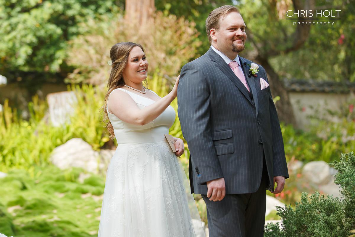 Bride taps Groom on shoulder for First Look