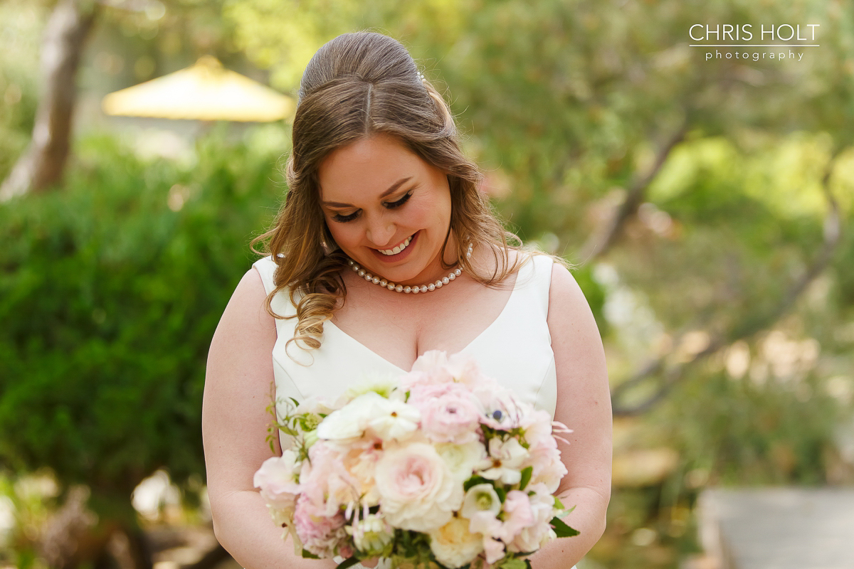 Happy bride with bouquet at Storrier-Stearns Japanese Garden