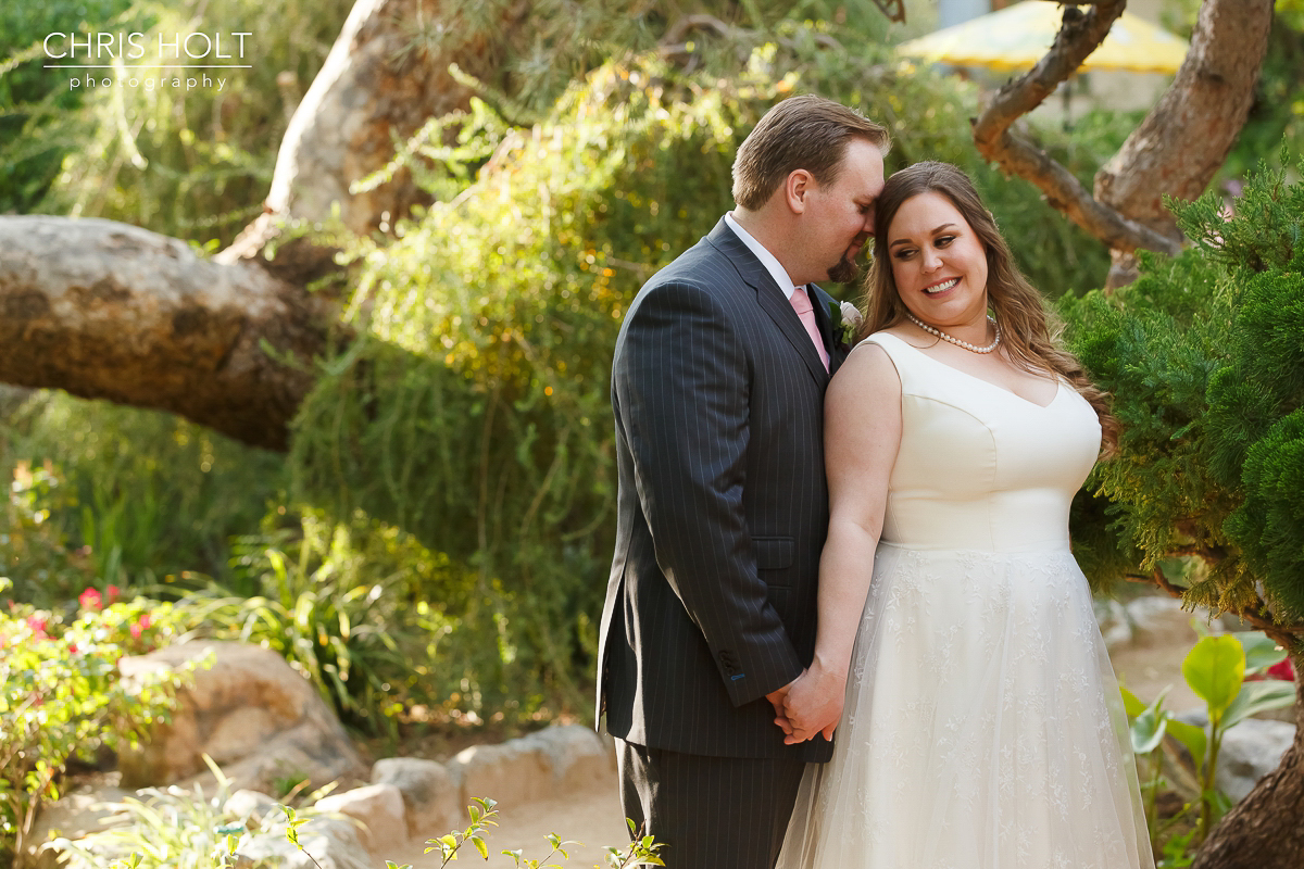 Bride and Groom happy romantic bridal portraits at Storrier-Stearns Japanese Garden