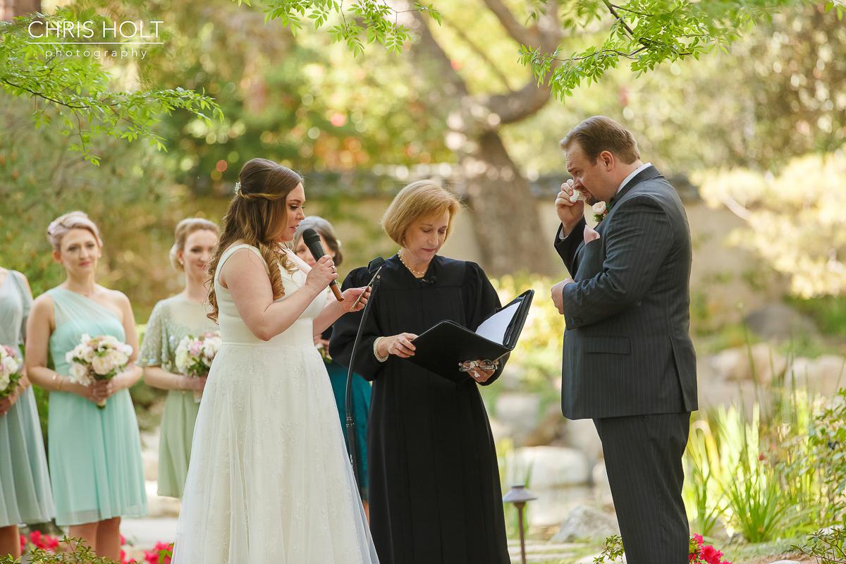 Bride and Groom exchange wedding vows at Storrier-Stearns Japanese Garden
