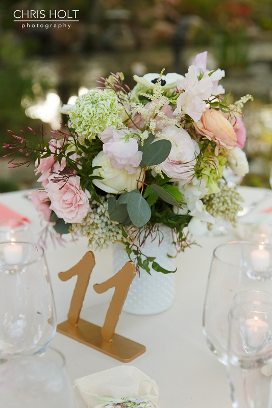 Floral centerpiece with table number by Wen Floral at Storrier-Stearns Japanese Garden
