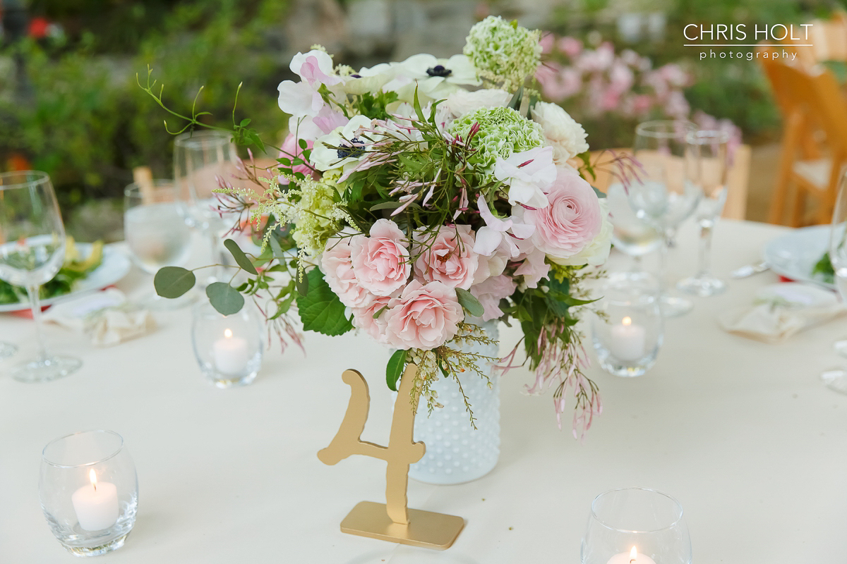 Floral centerpiece with gold table number by Wen Floral at Storrier-Stearns Japanese Garden