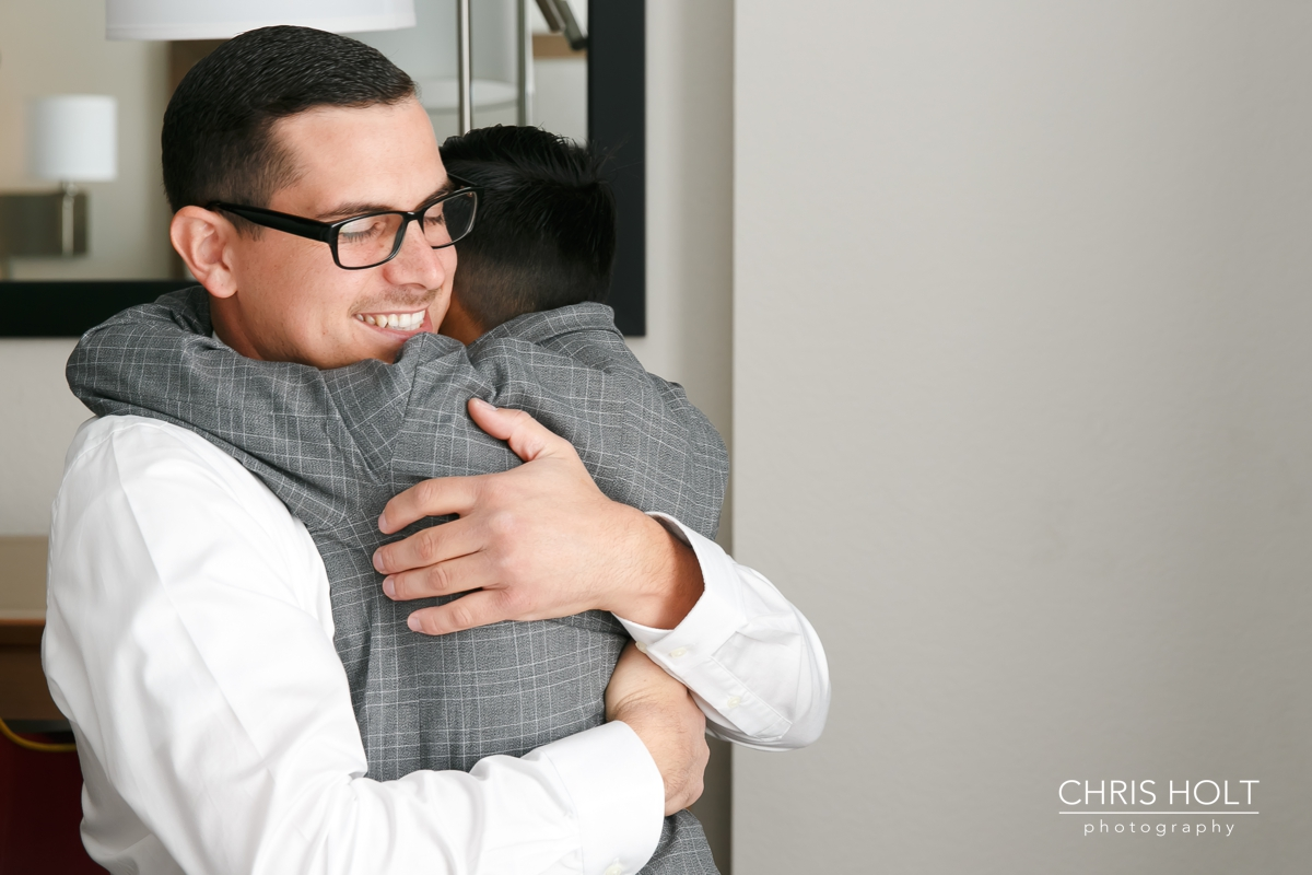 son hugging his dad the groom