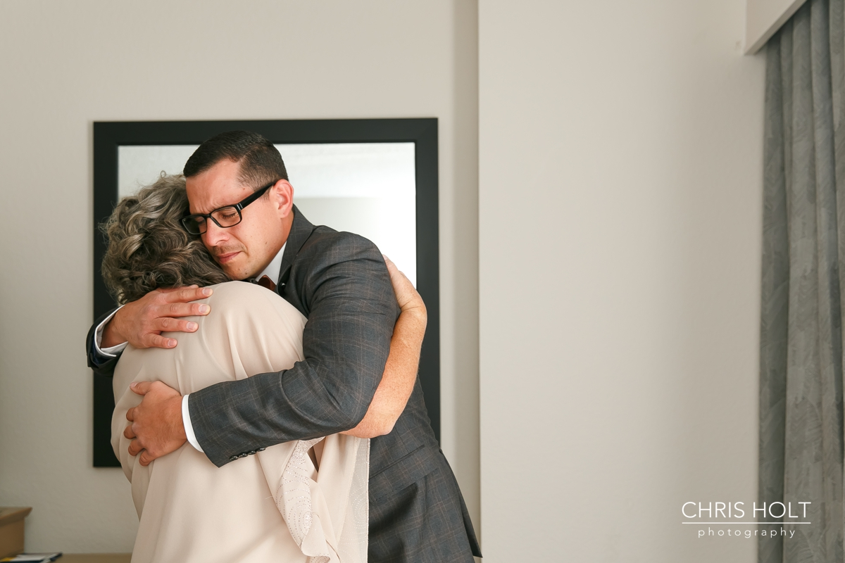 mother and groom hugging before the ceremony