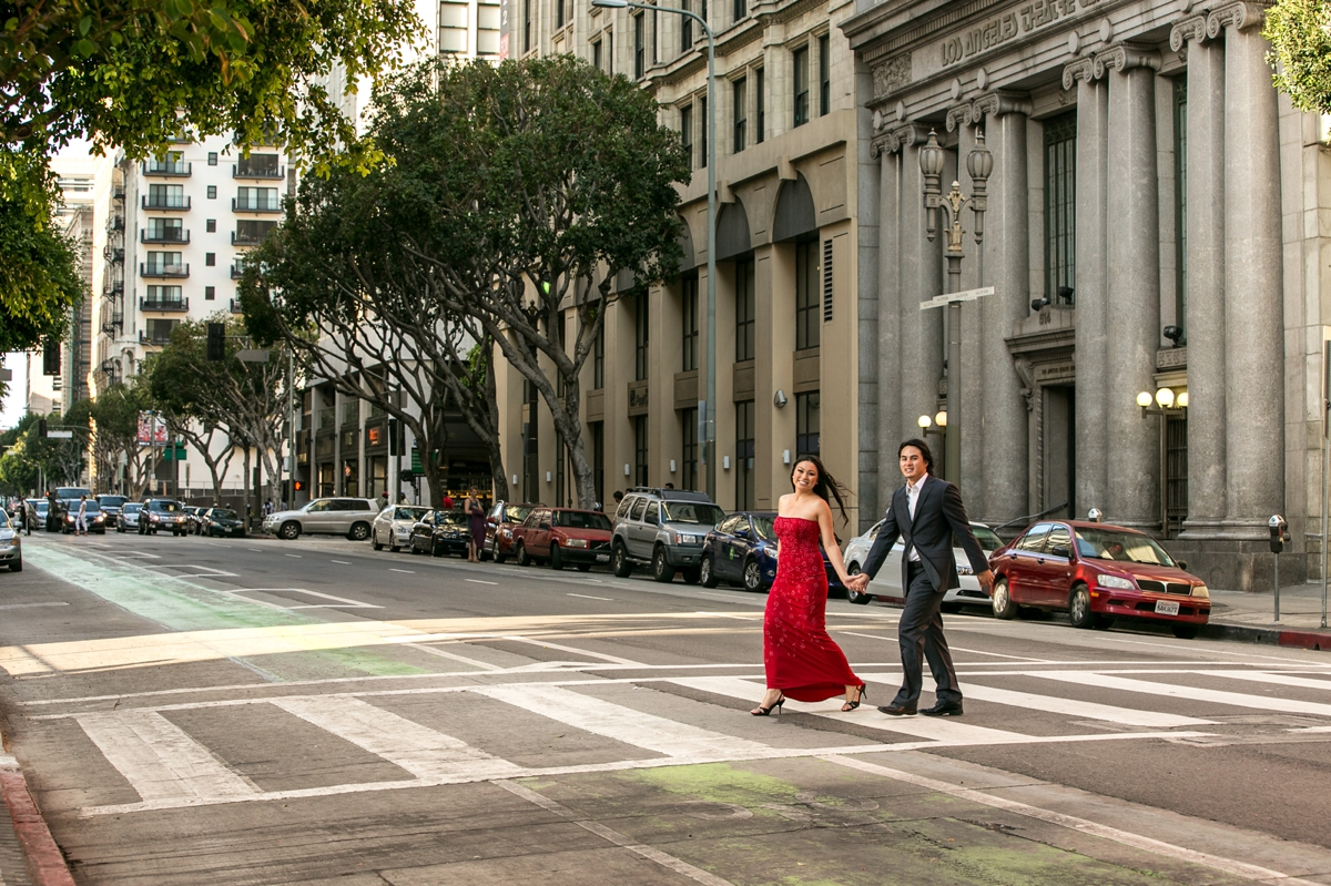 Jandy in her red dress and Wilson in Downtown LA for their urban engagement session near Vibiana
