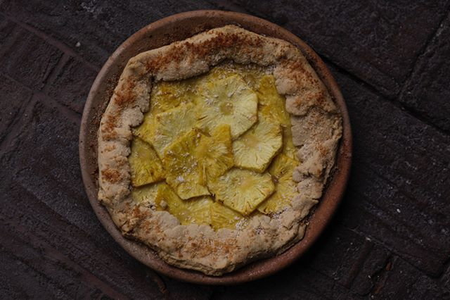 pineapple galette   lime salted caramel   toasted coconut  I used the same 'free form pastry' (no recipe or measurements) for this galette, and amazing pineapples from the Tlacolula markets - I'm saving the skins to make tepache this weekend. I also cooked this on one of the many clay plates in the house here and served it straight from the same plate.  It felt good. Simple, minimal and delicious x Made extra sauce this time for @peggy_soria  