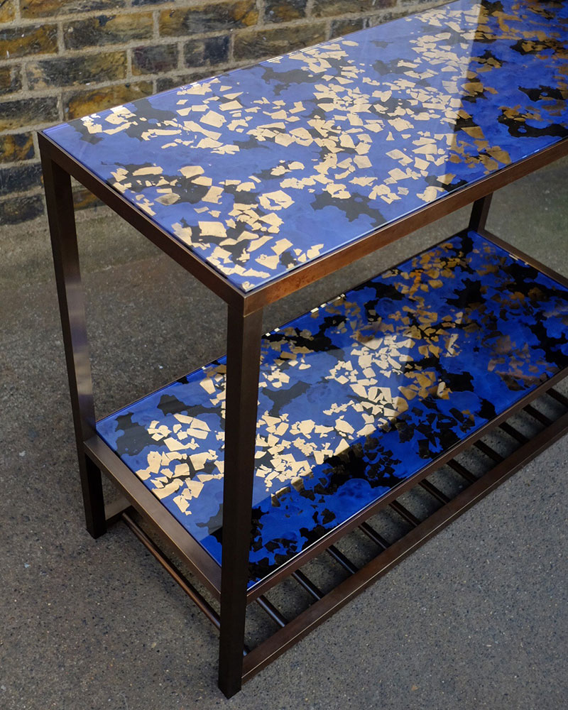 Cosmos console table in sapphire blue and antique bronze
