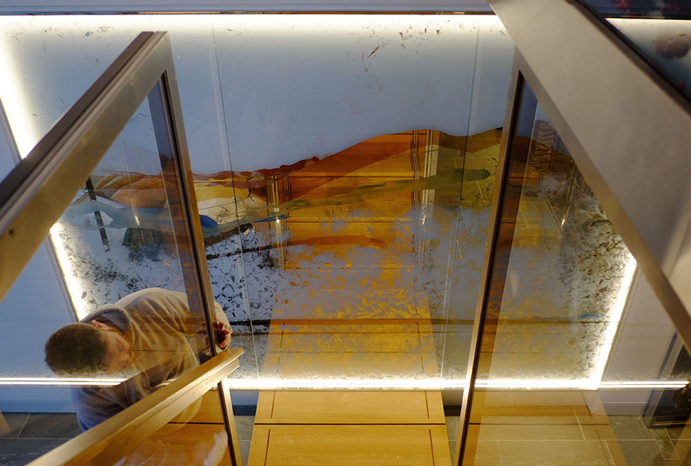 Inspired by the panoramic views of Lake Windermere and Langdale Pikes, this wall panel was created using gold leaf and inks and has integrated LED lighting.